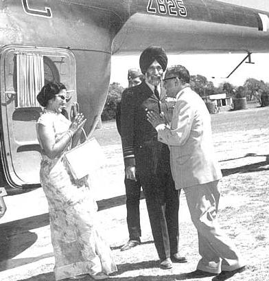 Mr. Kate receiving Air Marshal Arjan Singh and his wife