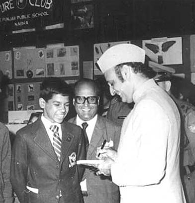 Maharaja Karan Singh signing autographs